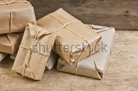 stock-photo-pile-parcel-wrapped-with-brown-kraft-paper-and-tied-with-twine-92255116